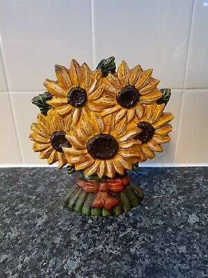 cast iron SUNFLOWERS heavy door stop nice old vintage piece