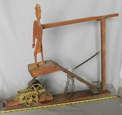 Antique American folk art carved dancing man toy clockwork mechanical spring