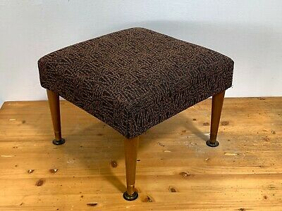 retro brown fabric upholstered mid century style footstool on tapered legs