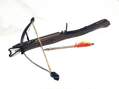 Medieval rudimentary crossbow  made out of wood,leather and steel. made in Italy