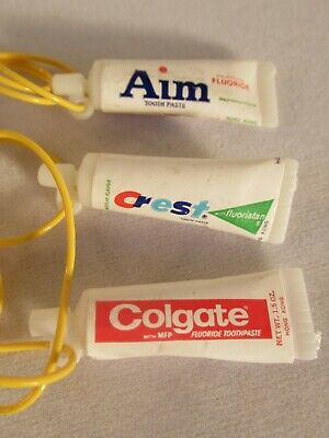 3 Vtg 1970 Aim/ Crest/ Colgate Toothpast Cracker Jack/ Gumball  Necklace/Charms