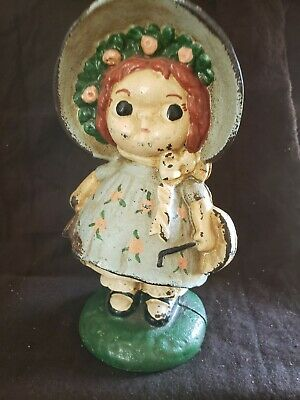 Antique Cast Iron Still Penny Bank Girl with Bonnet on her head.