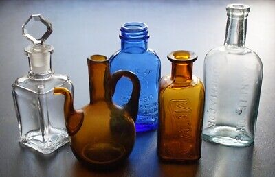 Antique Multi-Colored Five Piece Mixed Products Bottle Lot