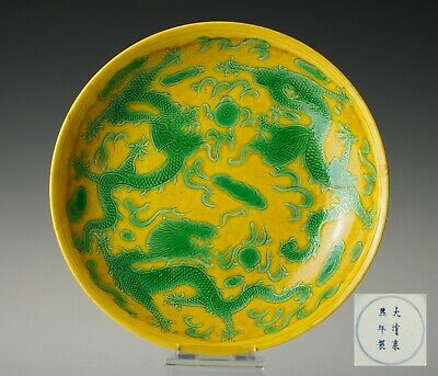 Kangxi mark dish with five-clawed, green enamelled, dragons on yellow ground