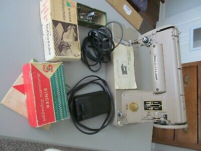 Vintage Singer Sewing Machine model 301a with accessories