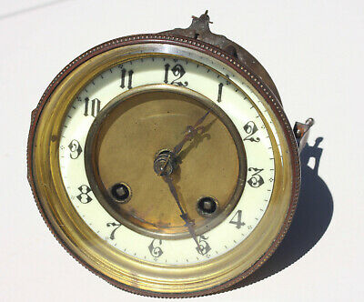 French clock movement complete with bezel & dial for spares or repair