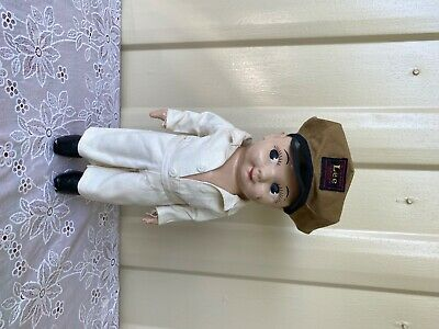 vintage buddy lee composition doll with a one piece suit