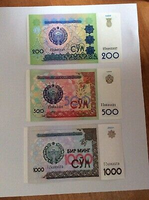 Uzbekistan Banknotes, Coins and Commemorative Postage Stamps Dating About 2004