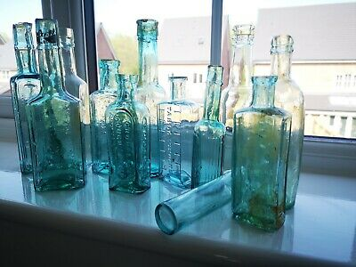 12X Vintage  glass  bottles,  some with writing on..