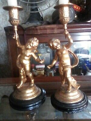 antique cherub candlesticks