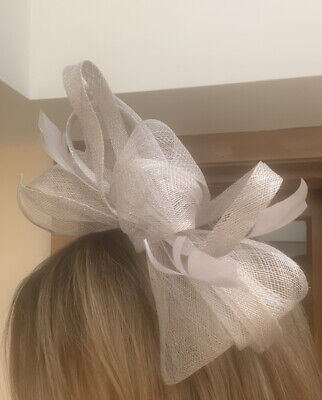 Beautiful light Grey feather & looped design facinator wedding/occasion