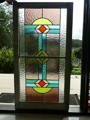Stained glass leadlight window in vintage timber frame