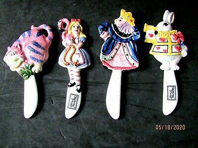 Four (4) Fitz & Floyd Alice In Wonderland Cheese Spread Knives