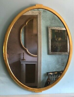 A Pair Of Large Mid 19Th Century Water Gilded Oval Mirrors