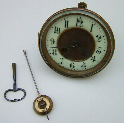 French Clock Movement, complete with dial & bezel, working order