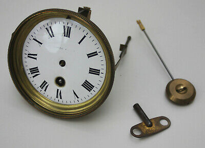 French clock movement in working order with key & pendulum