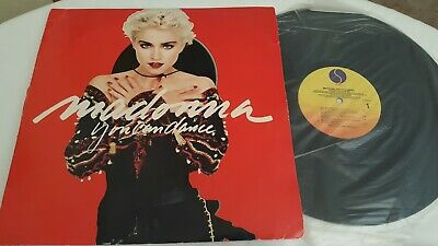 Madonna Record, 3 VHS tapes, 3 Cassette Tapes, and 1 Button