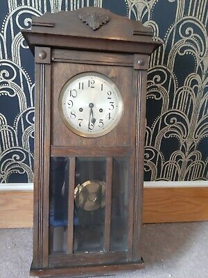 antique wall clock in dark wood