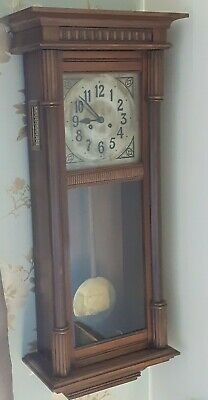 Antique Pendulum Chiming Wall Clock with Oak Casing Measuring 37 inches High