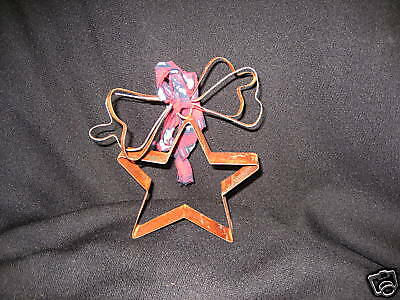Ornament rustic tin star ornament with bow