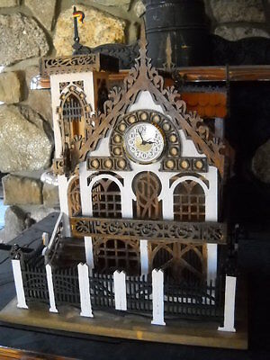 Wooden house clock reminiscent of german architecture by Jim Bean