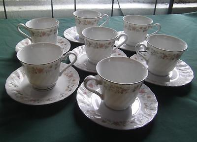 SET OF 7 SHEFFIELD PORCELAIN BOUQUET PATTERN FOOTED TEA CUPS & SAUCERS