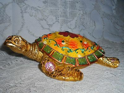 Colorful Turtle with Green Stones and Flower on Back