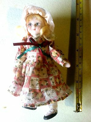 """6.5"""" tall porcelain doll pink and white dress and red and green bow"""