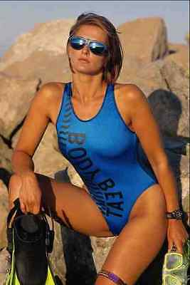 768050 Alex Brunette In A Blue Swimsuit With Diving Gear A4 Photo Print