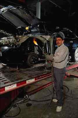730094 Industrial Worker With Flame Fixing Car Orange County California USA A4 P