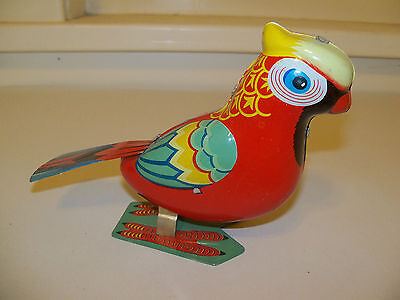 VINTAGE JAPAN TIN WIND-UP JUMPING ROCKING PARROT WITH KEY NICE WORKING CONDITION