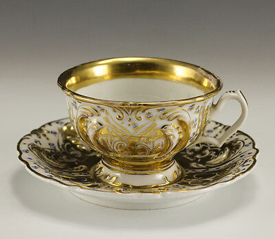 19th Century KPM Porcelain footed Cup and Saucer - Raised detail, gold gilt