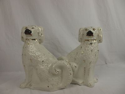 A Pair Of 19th Century Staffordshire Seated Spaniels