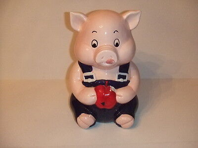 "SCHOOL PIG COOKIE JAR IN BLACK OVERALLS EATING A APPLE LICKING HIS LIPS 11"" TALL"