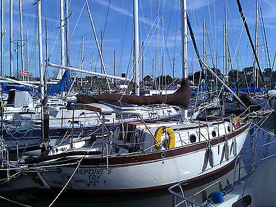 Sailboat Westsail 28' blue-water cruiser cutter double ender single hander.