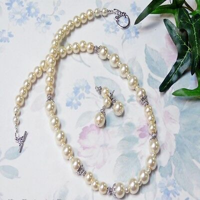 Classic cream pearl antique silver necklace and earring set, clip on or pierced.
