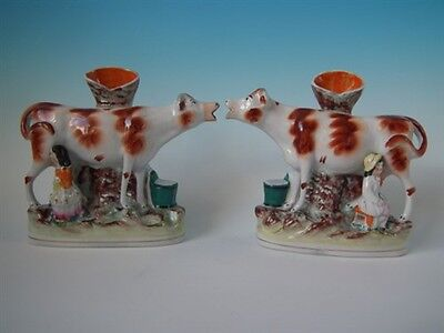 Pair Staffordshire cow & milkmaid/man spill vases