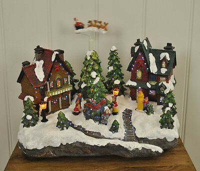 Kingfisher Christmas Village with Flying Sleigh and Sound Xmas Decoration