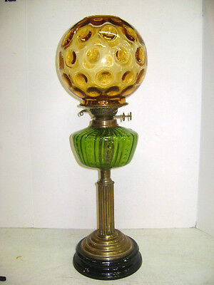 ANTIQUE BANQUET OIL LAMP WITH AMBER BALL SHADE