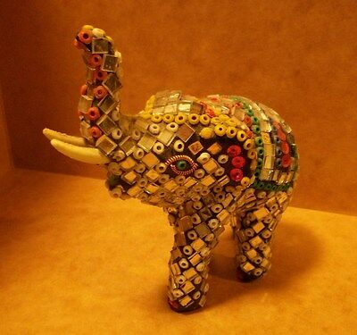 Perfect white elephant gift - a multi-colored small elephant Christmas gag gift