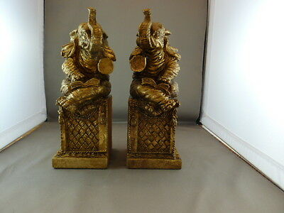 ELEPHANT BOOKENDS READING BOOK TRUNKS UP ON PEDESTAL LEGS CROSSED GOLD AFRICAN