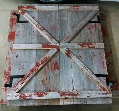 Custom reclaimed salvaged barn wood shutters
