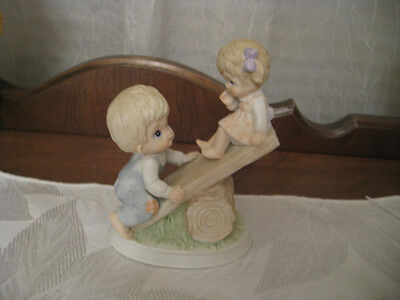 HOMCO #1406 PORCELAIN FIGURINE –BROTHER HOLDING HIS SISTER HIGH ON TEETER TOTTER