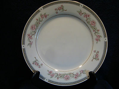 583 Twelve, China Pearl fine china dinner plate in the Irene pattern.