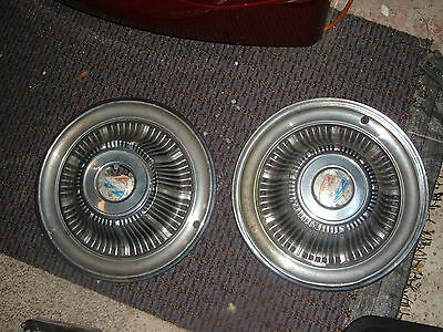 1965 BUICK HUBCAPS 14 INCH PAIR ONE IN GOOD CONDITION AND ONE IN FAIR CONDITION