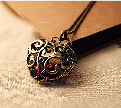 Free Fashion jewelry Hollow heart Bronze Retro long Pendant sweater Necklace N16