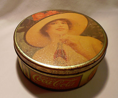 COCA-COLA  TIN   WITH   COCA-COLA  LADY  ON  TOP  OF  TIN