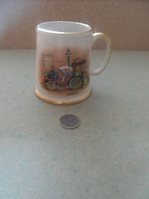 pottery tankard with vintage car and steam roller