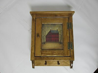 Amish made wooden wall cabinet with  print.Medium wood tone,solid pine