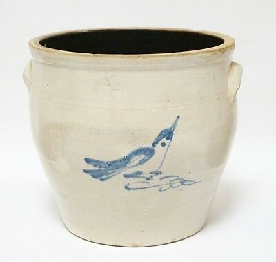 4 GALLON STONEWARE CROCK WITH A BLUE DECORATED BIRD. 11 INCHES TALL. Lot 1099